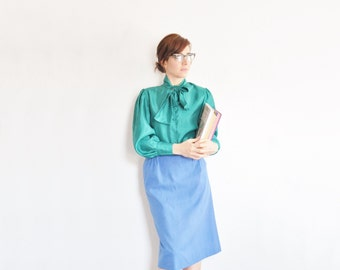 high waist bright blue skirt . pencil skirt with pleat back .small.medium .sale s a l e