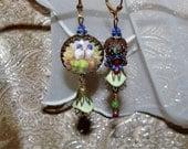 Love bird garden image cabochon woven jewel beaded bead asymmetrical earrings Pamelia Designs