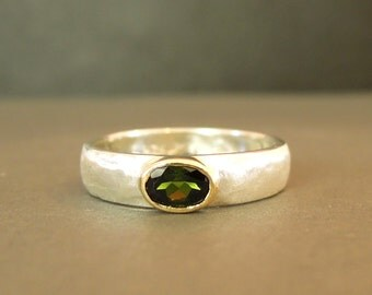 Green tourmaline ring set in gold and a matte silver band