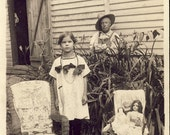 Little Girl with Her DOLLS On a CHAIR as GRANDPA Looks On Photo postcard circa 1910