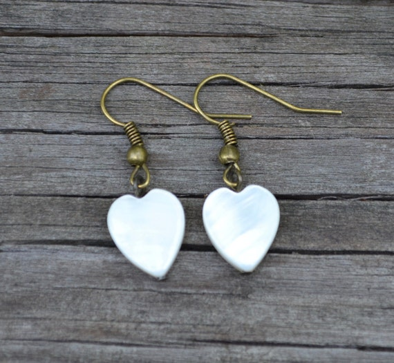 White Mother of Pearl Hearts . Earrings