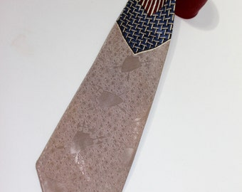 vintage 1950's -Penney's- Men's necktie Split color - Geometric center - Shield & Arms under-pattern. Red and Taupe.