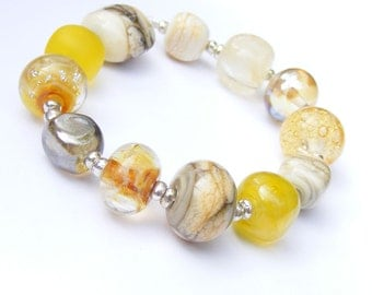 Handmade lampwork glass bead set of 12 cream and yellow orphan beads - yellow renegades