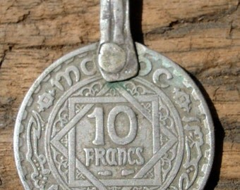 Moroccan 10 franc tarnished coin with loop or bail