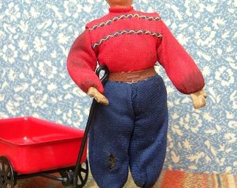 Vintage dollhouse boy