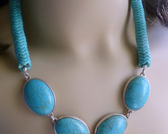 Blue turquoise beaded necklace, focal medallions set in silver