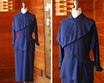 vintage 1950s dress / 50s dark blue wool peplum dress / size medium
