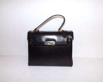 Vintage 1970s black leather traditional kelly grab handbag bag by Suzy Smith