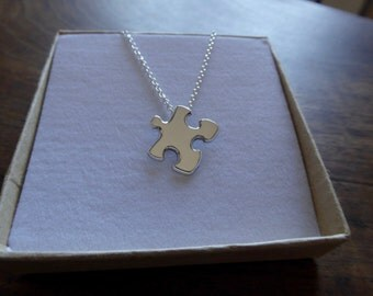 Miniature Silver Puzzle Piece Pendant Necklace, with chain at the back