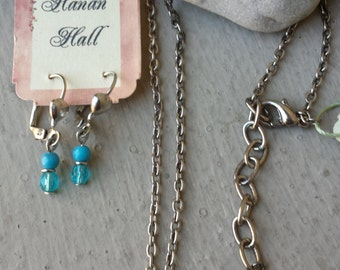 Dainty Aquamarine Crystal Pendant on Silver Tone Necklace by Steve Madden and Handcrafted Aquamarine Glass Earrings by Hanan Hall to Match!