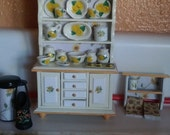 Darling miniature Sunflower collection in a kitchen cabinet