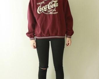 Vintage 1990's Coke Coca Cola Sweater Sweatshirt PULLOVER / 90s Jumper SLOUCHY Oversized Unisex Maroon Novelty Crewneck Soda Drinking
