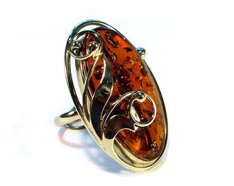 Natural Baltic cognac amber ring.