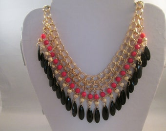 5 Row Bib Necklace with Black Teardrop Beads and Pink and Cream Color Beads on a Gold Tone Chain