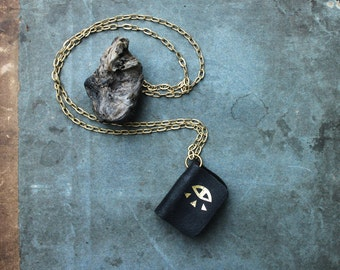 ORACLE book necklace - black leather and gold eye print