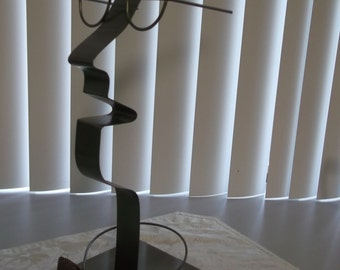 Free Form Metal Sculpture of Man Wearing Glasses