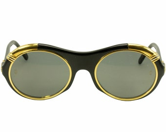 Must de Cartier Diabolo NOS 1990 vintage black & gold oversized round sunglasses, as worn by Lady Gaga