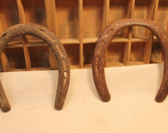 Two rusty old lucky horseshoes
