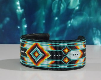Native American Beaded Cuff Bracelet In Turquoise, and With The Fire Colors Of The Southwest by LJ Greywolf