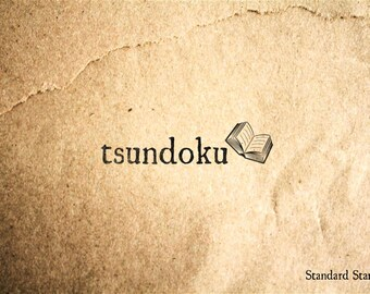 Tsundoku Japanese for Leaving a Book Unread Rubber Stamp - 2 x 1 inches