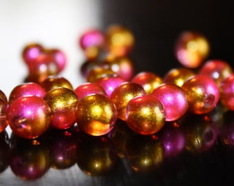 25 glass beads, 8 mm, round and smooth, transparent baking painted, hole 1 mm, gold and hot pink