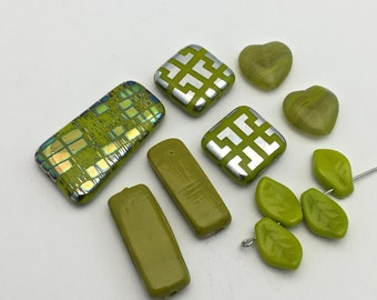 11  glass and ceramic beads green color #PV123