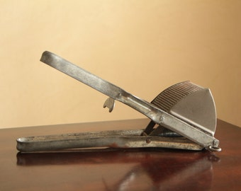 Vintage potato masher or potato ricer / industrial metal kitchen decor