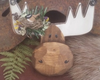 Wooden moose on a wire with chickadee in a nest on it's antler. Tooooo cute!