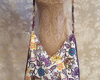 Zippered Hobo Bag - Creme with Purple Outlined Multi Colored Flowers with Purple Gusset