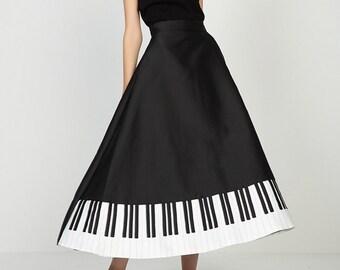 Walking in the music black and white piano elegant long skirt