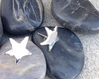Solid Silver Star post earrings.