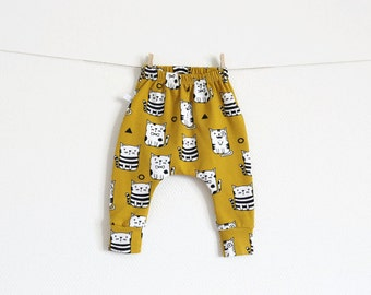 Baby infant pants with cats in mustard yellow. Slim fit harem pants with cuffs. Organic jersey knit. Infant leggings