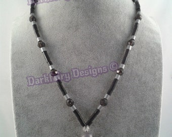 Beaded necklace with skull and cross bones