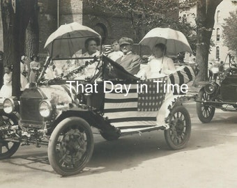 DIGITAL DOWNLOAD Vintage Photo-Old parade photo. July 4th. Flag. Patriotic. Vintage cars. Ladies with umbrellas. Men. Bystanders. RPPC.