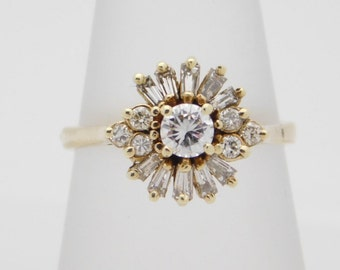 0.50 Carat T.W. Round & Baguette Cut Diamond Cluster Ring 14K Yellow Gold