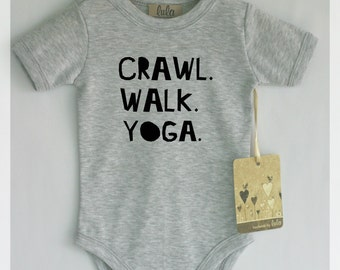 Crawl walk yoga baby bodysuit. Cute and modern baby clothes.
