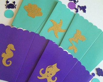 Set of 10 teal and purple under the sea treat boxes.
