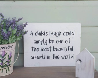 A child's laugh could simply be one of the most beautiful sounds in the world - Handpainted Rustic Aged Look Timber Wooden Sign  (35 x 27cm)