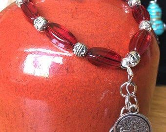 Red and silver beaded charm bracelet