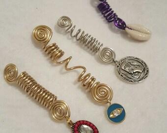 Four pieces of loc jewelry