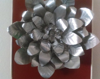 A beautiful flower made from aluminum cans