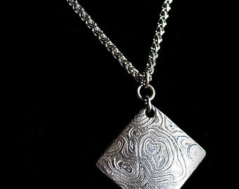 Stainless Damascus Steel pendant. Hand forged. One of a kind.