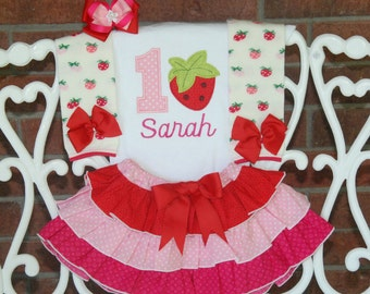 4 pc. Girls Strawberry Birthday Outfit! Strawberry birthday outfit with applique top, ruffle skirt, leg warmers, and hair bow!