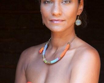 Colourful Maasai beadwork earrings a green or orange central bead
