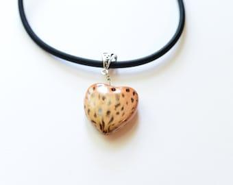 tan and brown heart pendant