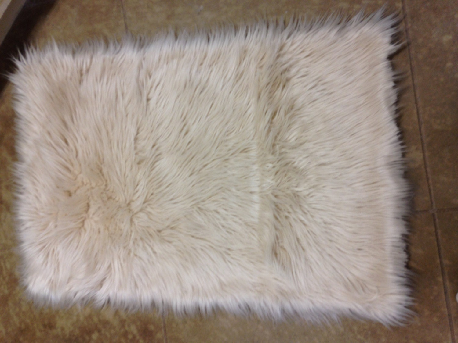 Tan luxury faux fur rug for Fur rugs