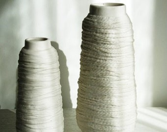 Coil of wire ceramic vases.