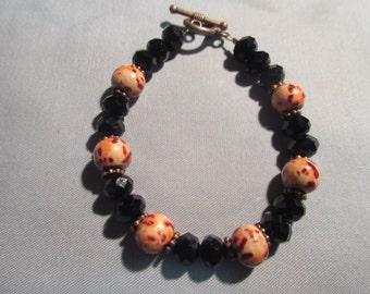 Leopard Print Wood and Black Glass Beaded Bracelet
