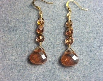 Rose gold briolette dangle earrings adorned with rose gold Czech glass beads.