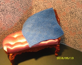 Small blue blanket in basket weave pattern